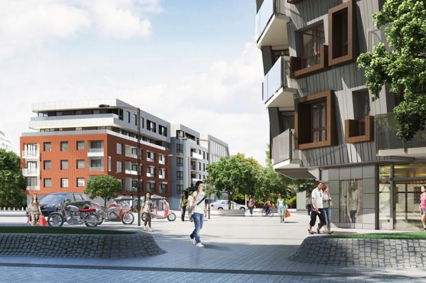 Po prawej budynek Hemara 3, centralnie budynek Hemara 2 znajdujący się po drugiej stronie osiedlowej uliczki.