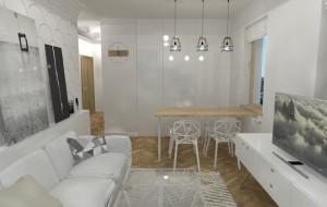 Mały pokój z aneksem. Kuchnia całkowcie ukryta w zabudowie