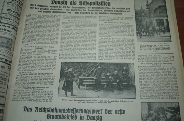 """Propagandowe ujęcie z Biskupiej Górki z końca września 1939 r. Więźniowie przetrzymywani na Biskupiej Górce pod strażą gdańskiego policjanta pomocniczego (z """"Danziger Vorposten"""", 22.10.1939)"""