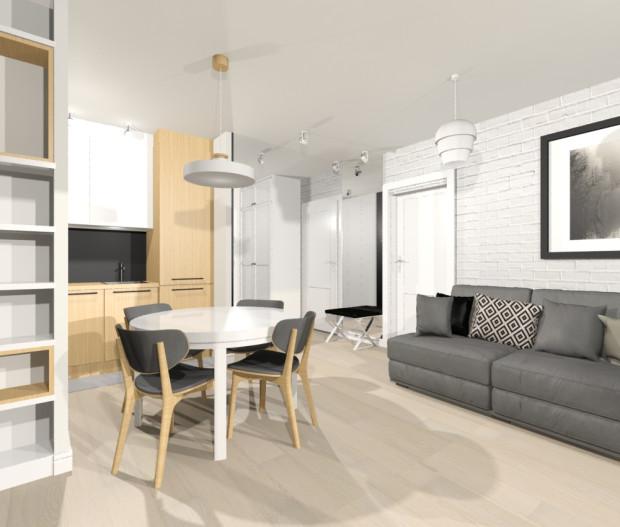 Na ścianie pokoju została umieszczona biała cegła, która podkreśla skandynawski charakter mieszkania.
