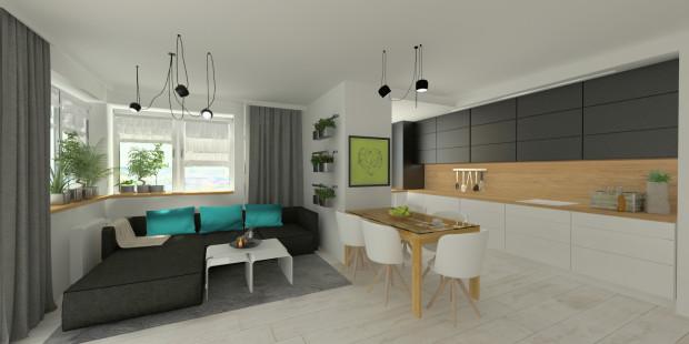 W pierwszej koncepcji część dzienną oddzielono od kuchni ścianą i stołem jadalnianym.