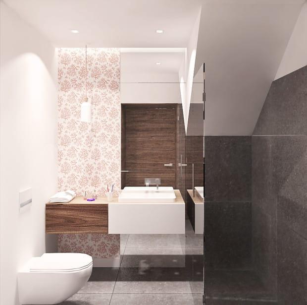 Zamiast układania płytek na wszystkich ścianach łazienki część z nich możemy pomalować odpowiednią farbą lub wytapetować.