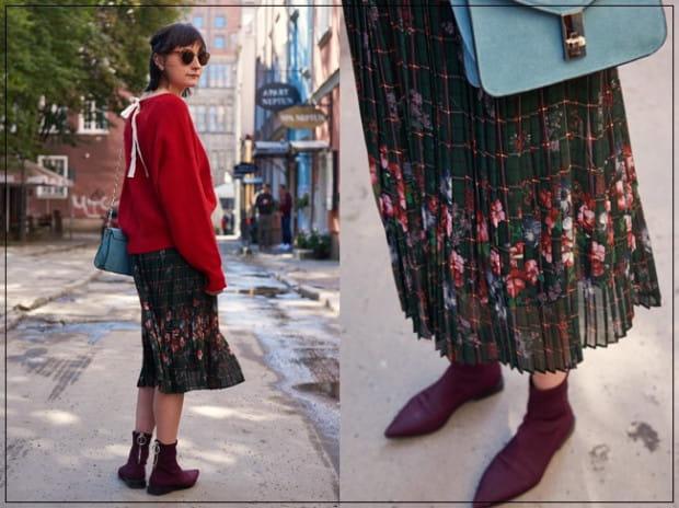 Asia uwielbia kwiaty i często wykorzystuje ich motyw w codziennych stylizacjach. Połączenie ciepłego swetra w modnym kolorze czerwieni z kwiecistą spódnicą midi to strzał w dziesiątkę. Asia wygląda w takim wydaniu uroczo i niezwykle dziewczęco.