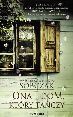 """Małgorzata Oliwia Sobczak """"Ona i dom, który tańczy"""", okładka książki."""