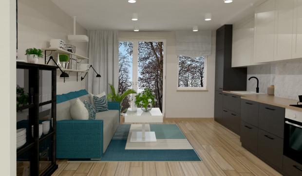 Koncepcja pierwsza. Sofa została skierowana w stronę kuchni, dzięki czemu domownicy mogą rozmawiać podczas wykonywania codziennych czynności w kuchni.