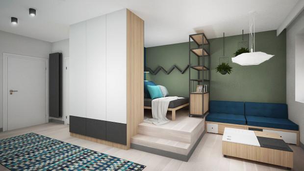 W pierwszej wersji przestrzeń sypialniana została wydzielona przy pomocy szafy i regału, które pełnią funkcje przechowywania.