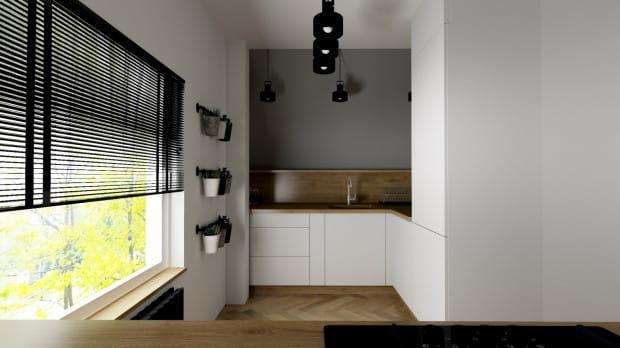 """Koncepcja pierwsza. Skos """"odcięty"""" od zabudowy drewnianą półką oraz zdecydowanie innym, ciemniejszym kolorem niknie w pomieszczeniu i go nie pomniejsza."""