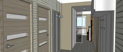 Zwężenie korytarza to tak naprawdę pojemna szafa z przesuwanymi drzwiami.