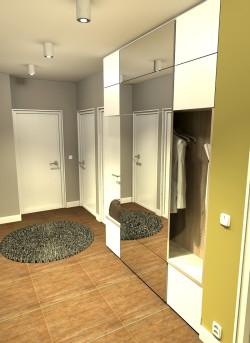 Wariant kolorystyczny łagodny. Widok od strony wejścia na mniejszą szafę. Niskie szafki to jednocześnie półka lub siedzisko.