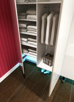 Wariant kolorystyczny intensywny. Duże gresowe płyty na podłodze ułatwiają utrzymanie czystości w przedpokoju, szczególnie wokół kuwety.